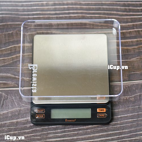 Cân Brewista có đi kèm 1 hộp phủ có chức năng chứa nguyên liệu cần cân
